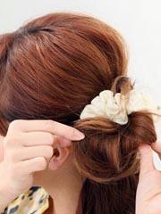 中长发扎韩式花苞头的扎法图解