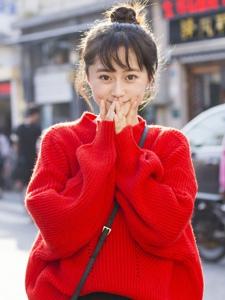 红色毛衣丸子头美女清新活力十足