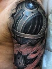 刚强有力的男性生物机械齿轮花臂纹身图案