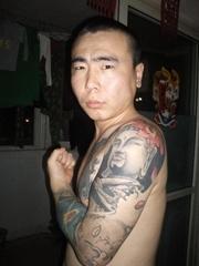 男人手臂艺术如来佛纹身图片