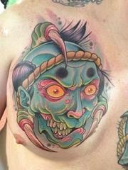 胸口一款school风格鬼头纹身图案