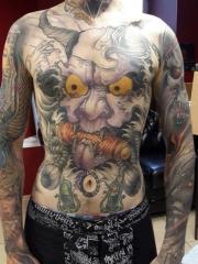 胸部面貌狰狞的般若霸气纹身图案