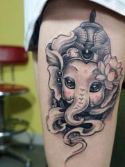 美女大腿可爱时尚的象神纹身图案