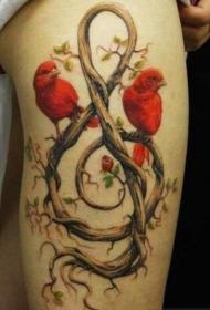 女人腿部潮流时尚的音符与小鸟藤蔓纹身图案