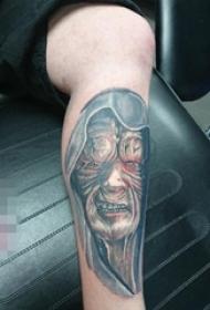 男生小腿上黑灰点刺技巧抽象线条人物肖像纹身图片