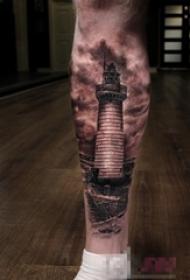 男生小腿上黑色素描点刺技巧灯塔纹身图片