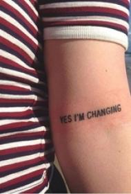 男生手臂上黑色线条花体有意义英文纹身图片