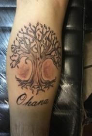 男生小腿上黑灰点刺植物大树纹身图片