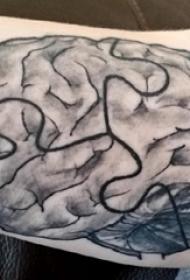 男生手臂上黑灰点刺抽象线条大脑纹身图片