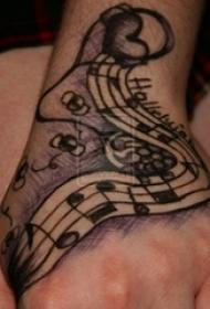 女生手背上黑灰素描点刺技巧创意音符文艺纹身图片