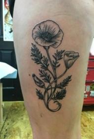 女生大腿上黑色点刺简单线条植物叶子和花朵纹身图片