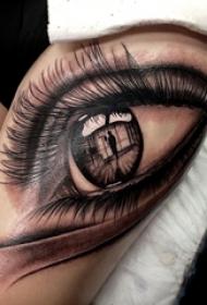 女生大腿上黑灰素描点刺技巧文艺唯美眼睛纹身图片