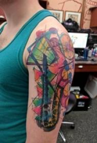 大臂纹身图 男生大臂上彩色的萨克斯纹身图片