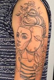 人物肖像纹身 男生大臂上面具和人物肖像纹身图片