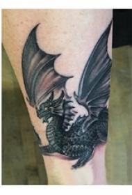 飞龙纹身图 男生手臂上飞龙纹身图片