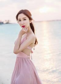 娄艺潇身穿露背长裙海边浪漫诱人图片