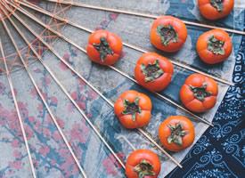 成熟的柿子吃起来甜甜的,凉凉的