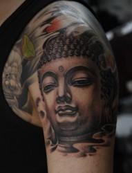 富有立体感的手臂佛头纹身
