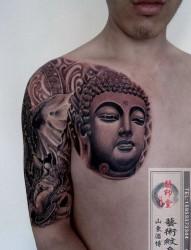 一幅潮流很酷的半甲佛头与象神纹身图片图片推荐