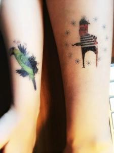 肉嘟嘟手臂上的可爱卡通纹身刺青