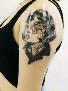 另类女孩手臂一款另类女孩纹身图案