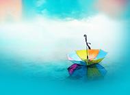 跌落的雨傘簡約清新背景圖