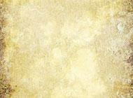 经过岁月洗礼的黄色纸张背景图片