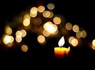黄色光晕与蜡烛背景图片素材