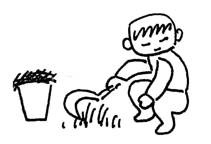 小男孩在割草