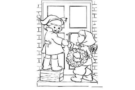 孩子们用圣诞花环装饰房子