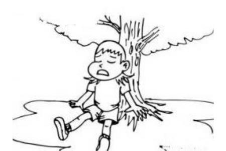 在树下休息的小男孩