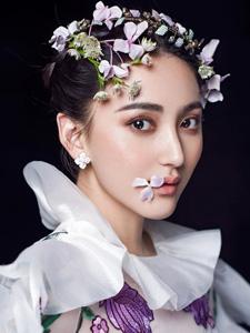 艾晓琪薄纱裹身演绎性感花仙子