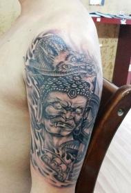 手臂霸气的龙和不动明王纹身图案