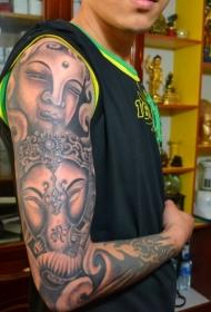 帅哥个性花臂佛像和象神纹身图案