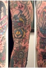 男生手臂上彩绘花臂建筑物与动物纹身个性纹身图片