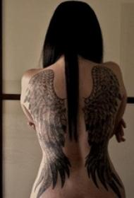 女生满背黑灰色个性线条翅膀纹身图片