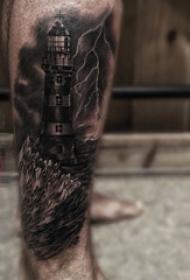 男生小腿上黑色点刺海浪和灯塔纹身图片