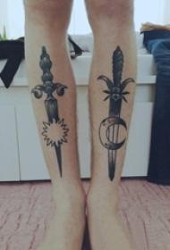 女生小腿上黑色点刺几何线条月亮太阳和匕首纹身图片