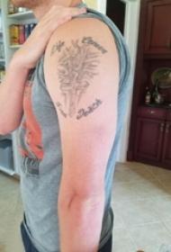 手臂十字架纹身男生手臂上十字架和英文纹身图片
