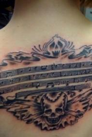 女生背部黑灰素描点刺技能创意霸气骷髅文艺音符纹身图片