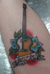 吉普森吉他纹身 男生小腿上花朵和吉他纹身图片