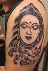 纹身佛像图 男生大年夜臂上莲花和佛像纹身图片
