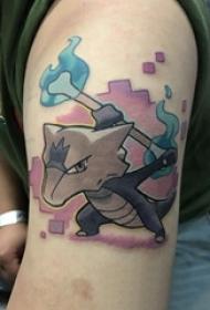 大年夜臂纹身图 男生大年夜臂上黑色的卡通纹身图片