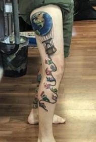 纹身腿部 男生腿部旗帜和热气球纹身图片