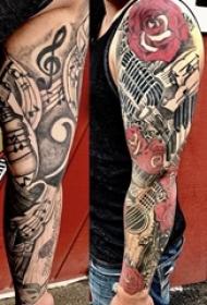 欧美花臂纹身 男生手臂上花朵和吉他纹身图片