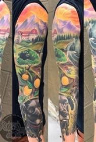 欧美花臂纹身 男生手臂上小狗和风景纹身图片