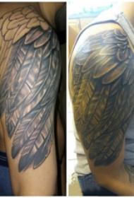 纹身天使同党 男内行臂上天使同党纹身图片