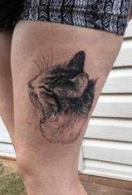 百乐动物纹身 女生大腿上黑灰的猫咪纹身图片