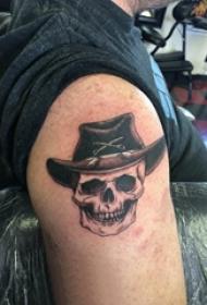 大臂纹身图 男生大臂上黑色的骷髅纹身图片