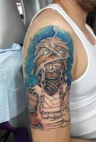 纹身木乃伊图片 男生大臂上彩色的木乃伊纹身图片